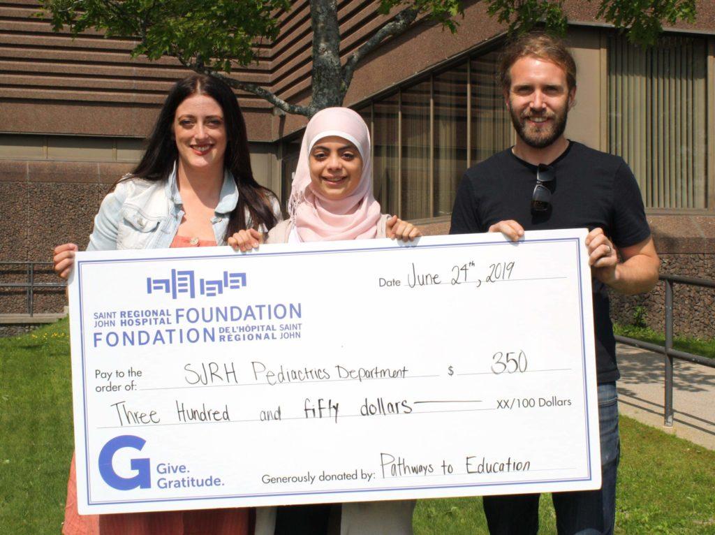 Alaa Al Rajeh with her $350 cheque for SJRH Pediatrics Department